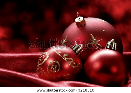 Pretty Christmas baubles with seasonal background - stock photo