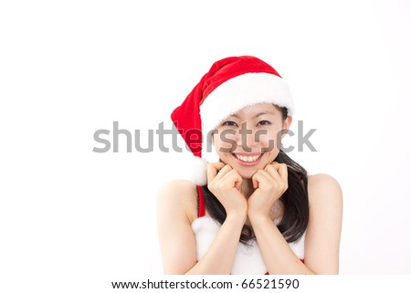 pretty christmas girl in red dress and santa hat - stock photo