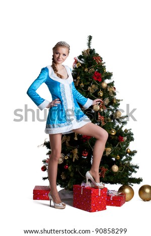 Pretty christmas girl stand with new year fir tree - stock photo