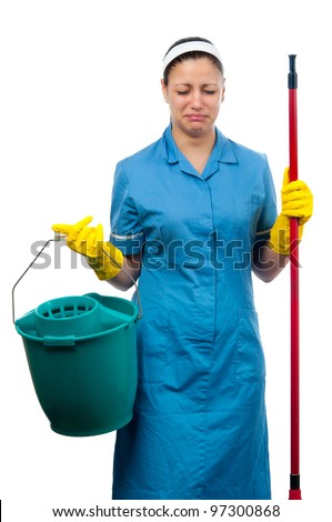 Pretty cleaning lady with bucket and broom crying isolated on white.