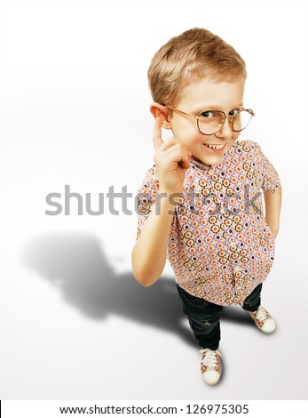 Pretty clever boy portrait with big shadow on white background - stock photo