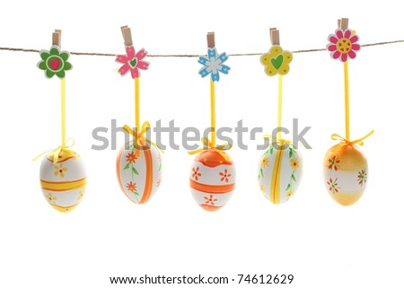 Pretty Colored Easter Eggs hanging on Ribbons with bows isolated on white - stock photo