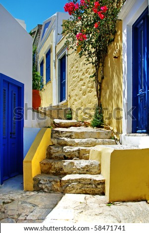 pretty colored streets of greek islands - stock photo