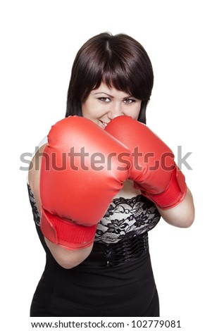 Pretty confident young woman with boxing gloves