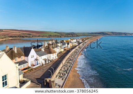 Pretty cottages at Torcross on the Devon coast, the village sits on a strip of land overlooking Slapton Sands beach with a fresh water lake behind. - stock photo