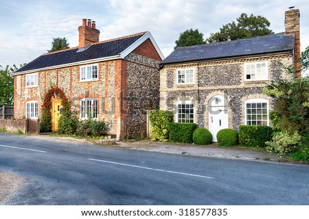 Pretty country cottages made from brick and flint in Norfolk