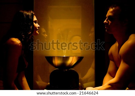 Pretty couple in the dark room with fountain