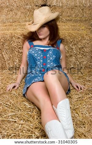 Pretty Cowgirl in Hay - stock photo