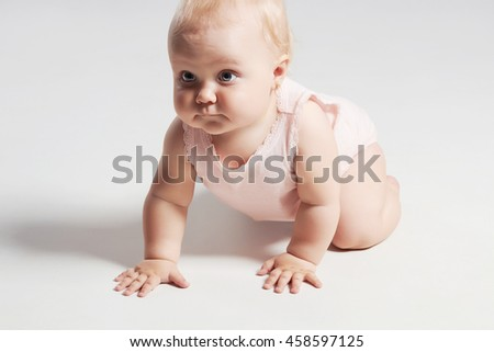 pretty crawling baby.portrait of adorable baby girl. funny child - stock photo