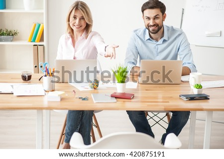 Pretty creative team is inviting their client - stock photo