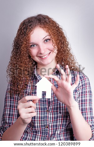 pretty curly girl builder with their dream house - stock photo