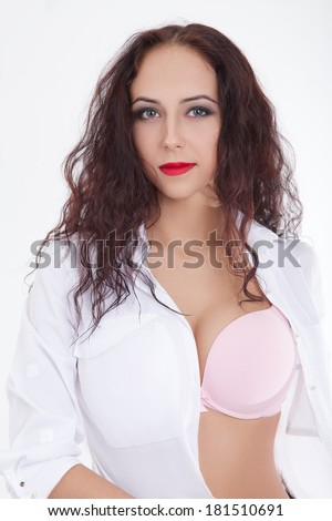 pretty curly girl in white shirt shows large breast - stock photo