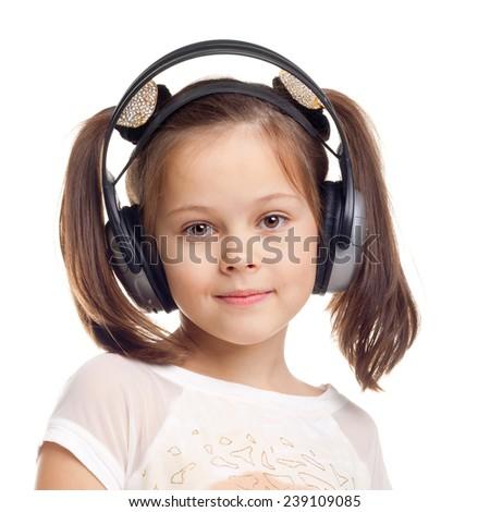 pretty cute little girl wearing the headphones - stock photo