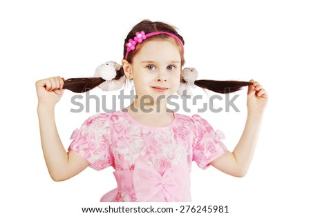 Pretty cute young girl holding her pigtails - stock photo