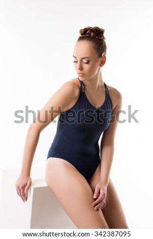Pretty dancer in blue bodysuit. Studio photo - stock photo