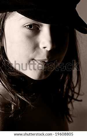 Pretty Dark Haired Child Looking at Camera - stock photo