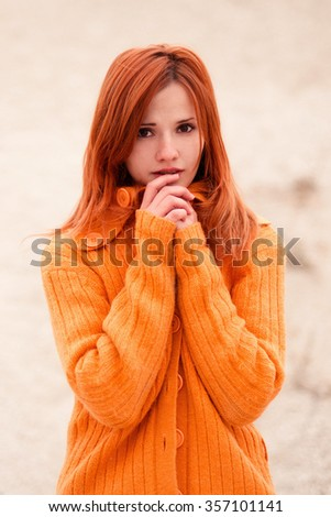 Pretty,depressed,fearful ,beautiful,surprised,frightened,amazed,shocked,scared red-haired girl has mane phobias,horrors,her face is light,white,pale.Brown eyes,fashion style.Attractive,trendy person. - stock photo