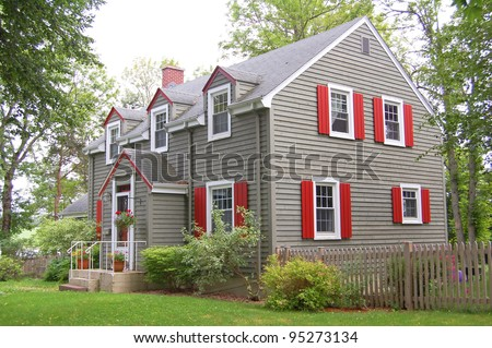pretty detached house with clapboard design - stock photo