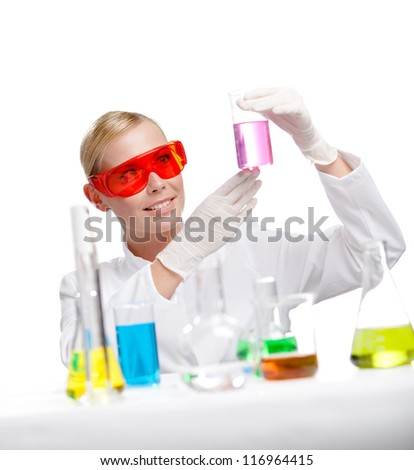 Pretty doctor keeps a beaker with purple liquid, isolated on white - stock photo