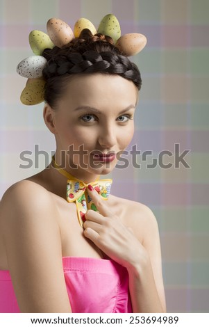 pretty easter girl with eggs on hair - stock photo