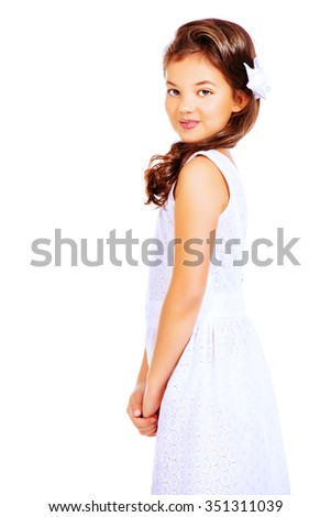 Pretty eight-year girl wearing white dress. Studio shot. Kid's beauty, fashion. Isolated over white.  - stock photo
