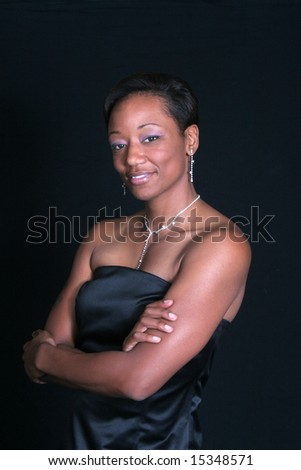 Pretty elegant black woman with arms folded - stock photo