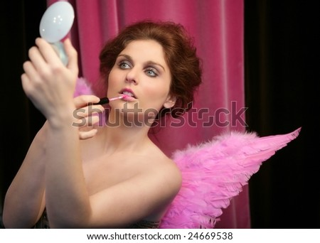 Pretty elegant pinup girl, lipstick and fink feather wings - stock photo
