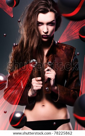 pretty erotic devil woman in leather jacket with laser lights - stock photo