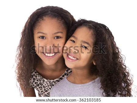 pretty ethnic sisters on white isolated background