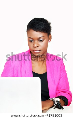 Pretty ethnic woman busy on computer - stock photo