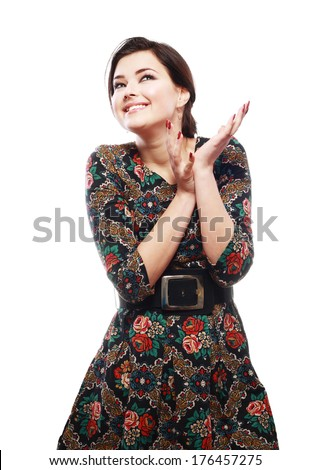 pretty excited woman happy smile looking up to copyspace - stock photo