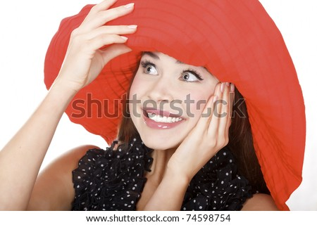 Pretty excited woman in red hat posing against white background. - stock photo