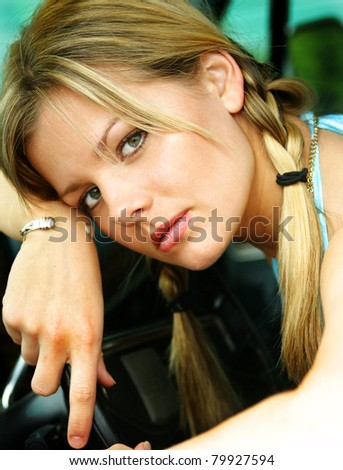 Pretty face of a blond caucasian woman. - stock photo