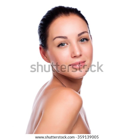 Pretty face of beautiful smiling woman - posing at studio isolat - stock photo