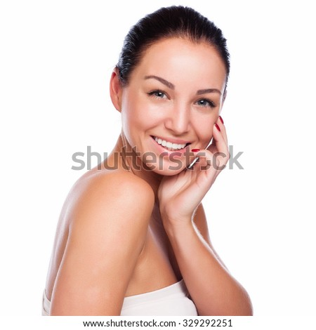 Pretty face of beautiful smiling woman - posing at studio isolated