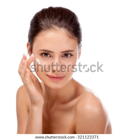 Pretty face of beautiful smiling woman - posing at studio isolated on white - stock photo