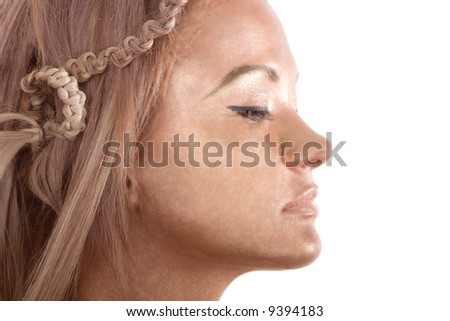 Pretty face of blond glamour girl with painting skin in gold dye over white background - stock photo