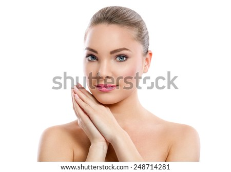 Pretty face of young beautiful woman with healthy skin - isolated on white - stock photo