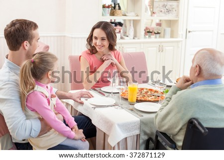 Pretty family has a lunch together - stock photo