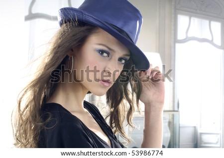 pretty fashionable girl with retro hat in the studio - stock photo
