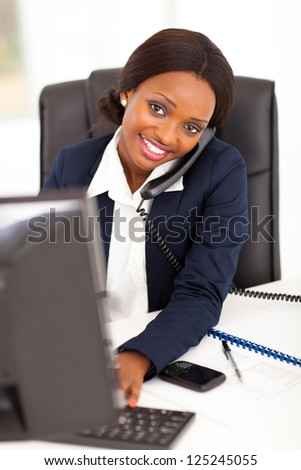 pretty female african corporate worker working in office - stock photo