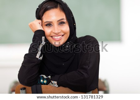pretty female Arabic college student in classroom - stock photo