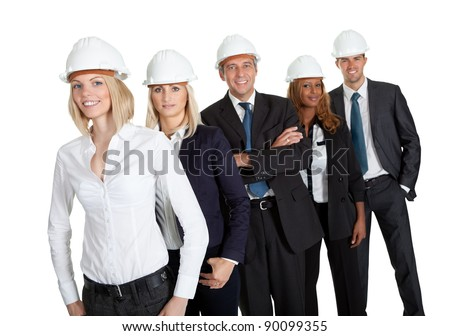 Pretty female civil engineer standing with her team on white background - stock photo