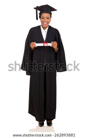 pretty female college graduate in gown and cap on white background - stock photo