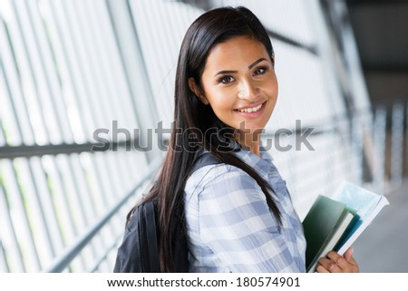 pretty female college student going to attend class - stock photo