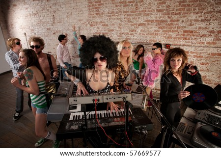 Pretty Female DJs Rocking a Disco Music Party - stock photo