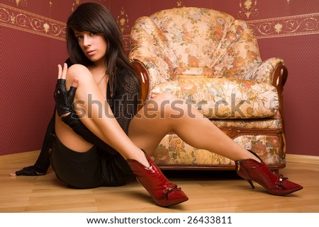 Pretty female model on the red background.