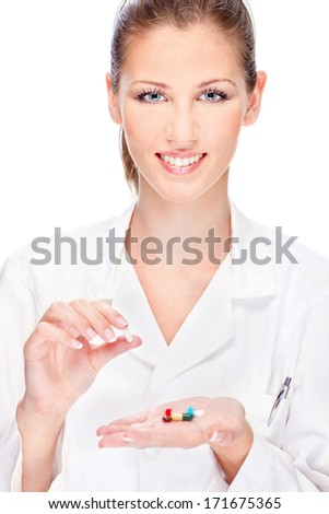 Pretty female nurse holding  medicals, isolated on white