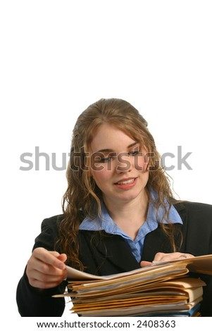Pretty female office worker looking at files - stock photo