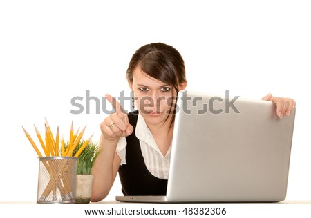 Pretty female office worker with laptop computer - stock photo